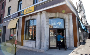 In this March 20, 2012 file photo, a patron enters a Laurentian Bank in Montreal. THE CANADIAN PRESS/Paul Chiasson