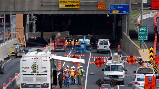 Engineers inspect a concrete slab that fell on a major expressway Monday, August 1, 2011 in Montreal. (Paul Chiasson / THE CANADIAN PRESS)