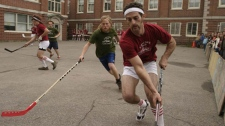 The Sam Jam is a day of intense street hockey competition in a lighthearted atmosphere, as evidenced by the ridiculous mustache and wig on these players.
