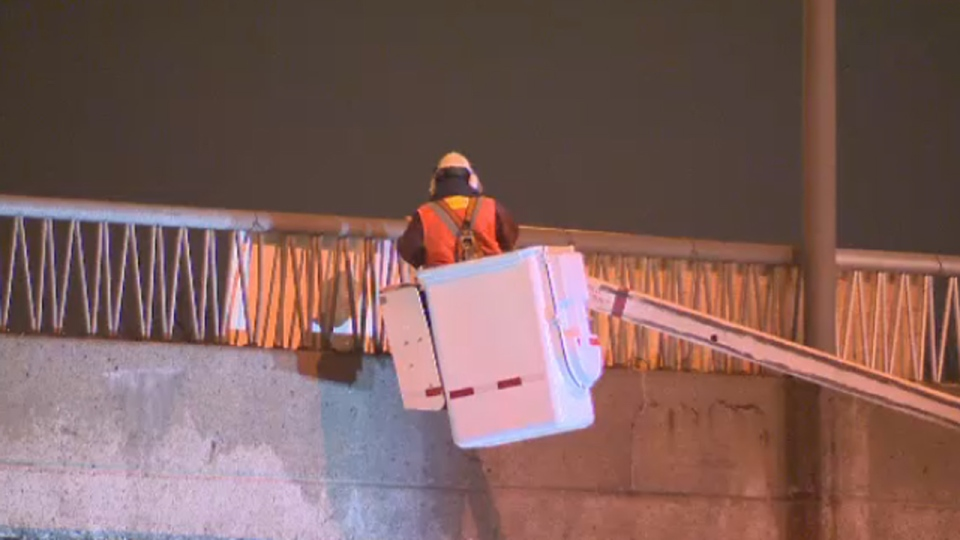 An engineer looks at the Henri Bourassa overpass several hours after a piece of concrete fell onto a car (Jan. 14, 2014)