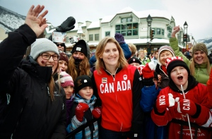 Hayley Wickenheiser, centre, a member of Canada's women's hocley team is surrounded by fans during a send-off party for Canada's Sochi bound Olympic athletes in Banff, Alta., Saturday, Jan. 11, 2014.THE CANADIAN PRESS/Jeff McIntosh