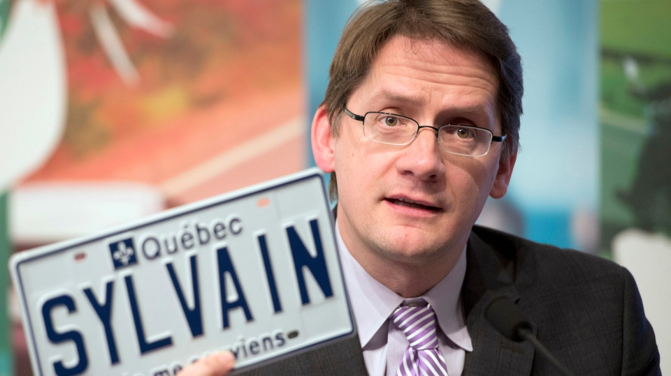 Quebec Transport Minister Sylvain Gaudreault announces the option to have personalized license plates, Thursday, January 30, 2014 in Quebec City. THE CANADIAN PRESS/Jacques Boissinot
