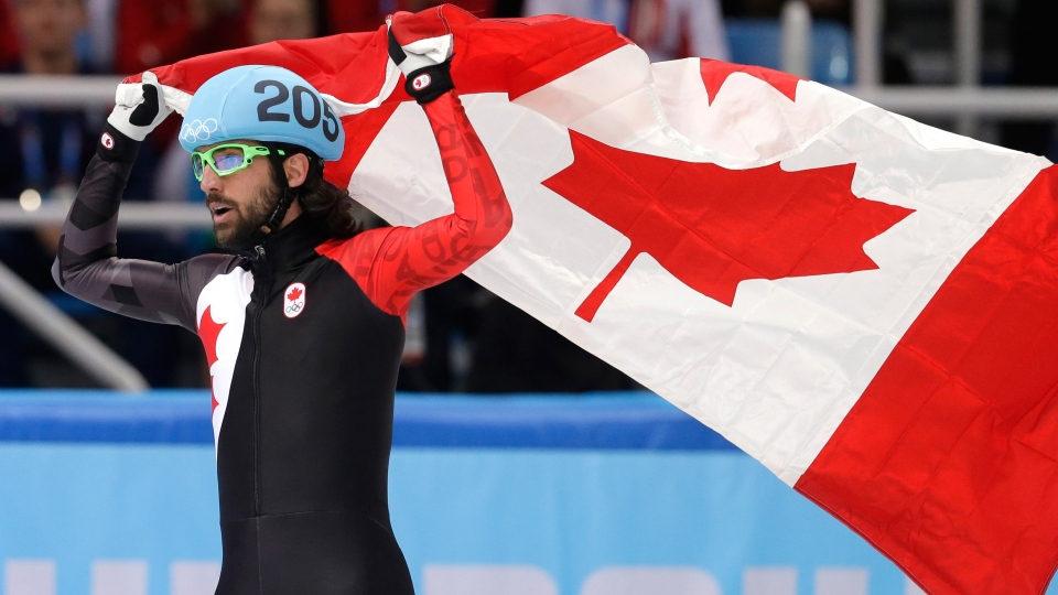 Charles Hamelin of Canada celebrates winning the men's 1,500-metre short track speed skating final at the Iceberg Skating Palace during the 2014 Winter Olympics, Monday, Feb. 10, 2014, in Sochi, Russia. (AP / Darron Cummings)