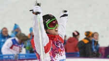 Alex Bilodeau celebrates men's moguls gold medal