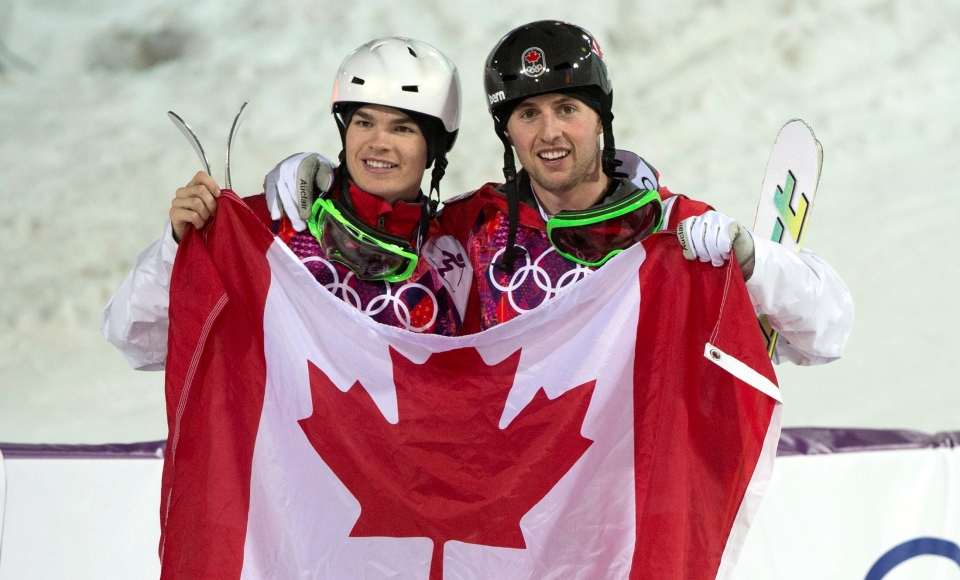 Canadians Alex Bilodeau, gold medallist, right, and silver medallist Mikael Kingbury celebrate their win following the moguls finals at the Sochi Winter Olympics in Krasnaya Polyana, Russia, Monday, Feb. 10, 2014. (Jonathan Hayward / THE CANADIAN PRESS)