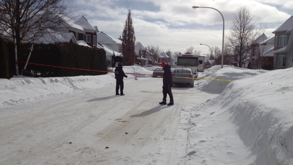 Police officers in Trois Rivieres closed off Sicard St. after three bodies were discovered on Feb. 11, 2014 (CTV Montreal/Wayne Toplosky)
