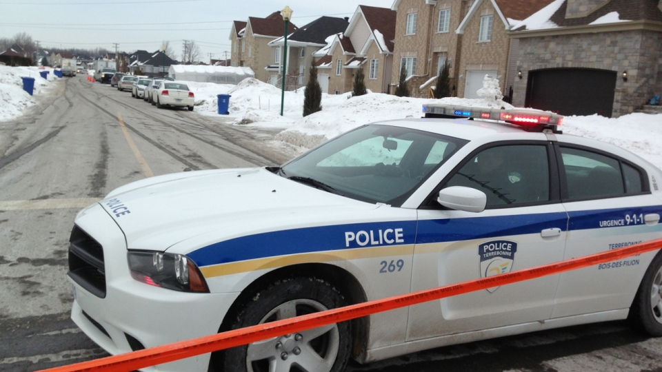Terrebonne police have cordoned off a large area around a home where two bodies were discovered on Thursday, Feb. 13, 2014 (CTV Montreal/Pedro Querido)