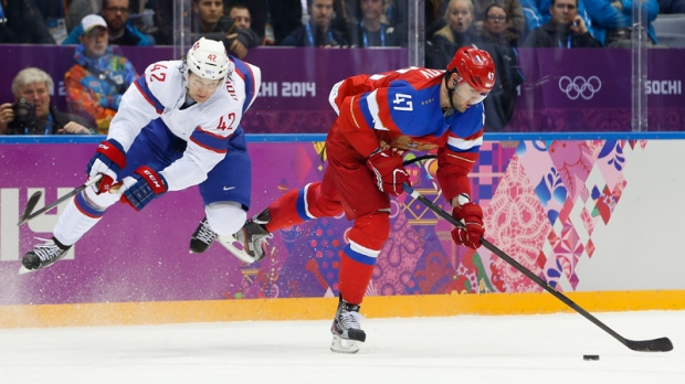 Norway defenceman Henrik Odegaard defends as Russia forward Alexander Radulov takes an off balance shot in the second period of a men's ice hockey game at the 2014 Winter Olympics, Tuesday, Feb. 18, 2014, in Sochi, Russia. (AP Photo/Mark Humphrey)