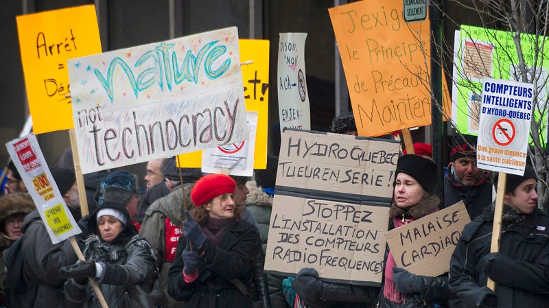 Protesters demonstrate outside a televison studio in Montreal, Thursday, March 27, 2014, ahead of a Quebec provincial election leaders debate. THE CANADIAN PRESS/Graham Hughes