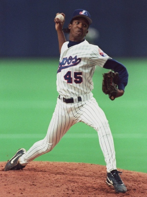 3-	Montreal Expos pitcher Pedro Martinez fires a p