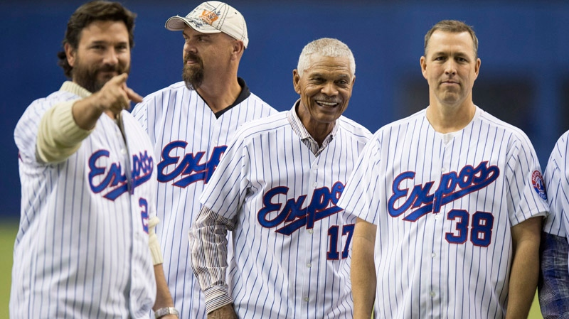 Former Montreal Expos Darren Fletcher, Larry Walker, manager Felipe alou and Denis Boucher, left to right, line up as members of the 1994 team are introduced prior to a pre-season game with the Toronto Blue jays facing the New York Mets Saturday, March 29, 2014 in Montreal. THE CANADIAN PRESS/Paul Chiasson