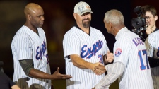 Former Montreal Expos manager Felipe Alou shakes h