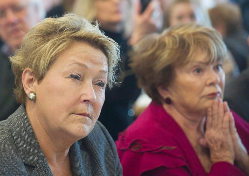Parti Quebecois leader Pauline Marois, left, sits next to women's rights activist Janette Bertrand during a Quebec provincial election campaign stop at a restaurant in Laval, Que., Sunday March 30, 2014. THE CANADIAN PRESS/Graham Hughes