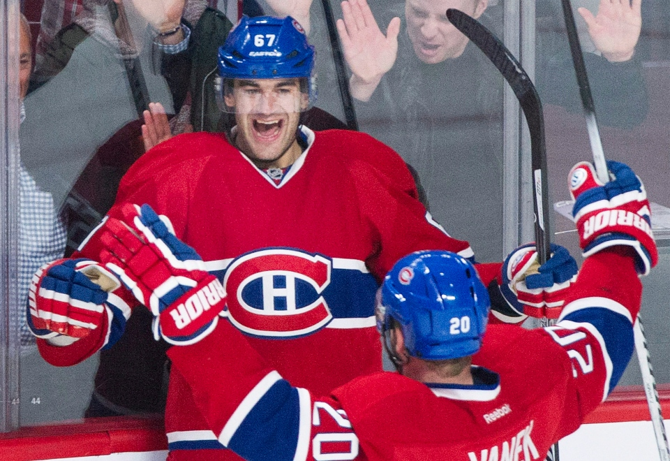 Montreal Canadiens' Max Pacioretty (67) celebrates with teammate Thomas Vanek after scoring against the Detroit Red Wings during second period NHL hockey action in Montreal, Saturday, April 5, 2014. THE CANADIAN PRESS/Graham Hughes