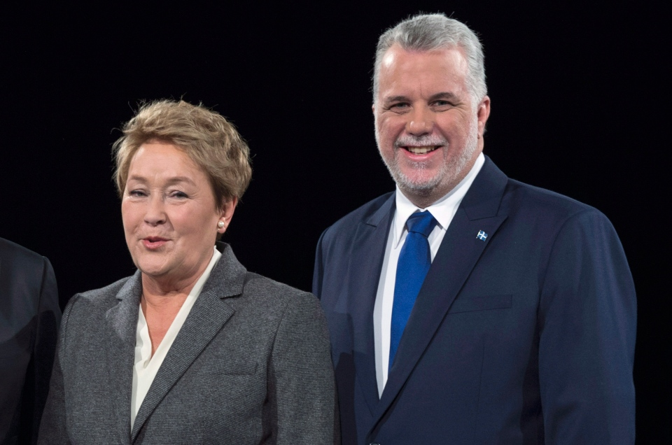 The frontrunners in the 2014 Quebec election campaign, Liberal leader Philippe Couillard and PQ leader Pauline Marois, posed for this photograph prior to the leaders' debate Thursday, March 20, 2014 in Montreal. THE CANADIAN PRESS/Paul Chiasson