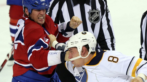 Montreal Canadiens left wing Travis Moen (32) trades punches with Buffalo Sabres left wing Cody McCormick (8) during second period NHL hockey action Tuesday, October 18, 2011 in Montreal.THE CANADIAN PRESS/Ryan Remiorz