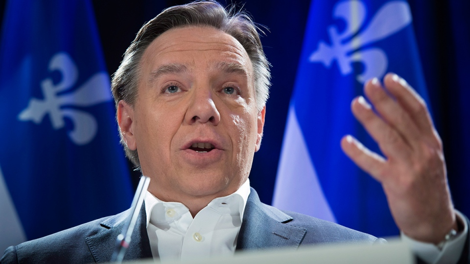 Coalition Avenir Quebec Leader Francois Legault responds to questions the day after the election of a Liberal majority government, in Montreal, Tuesday, April 8, 2014. (Paul Chiasson / THE CANADIAN PRESS)