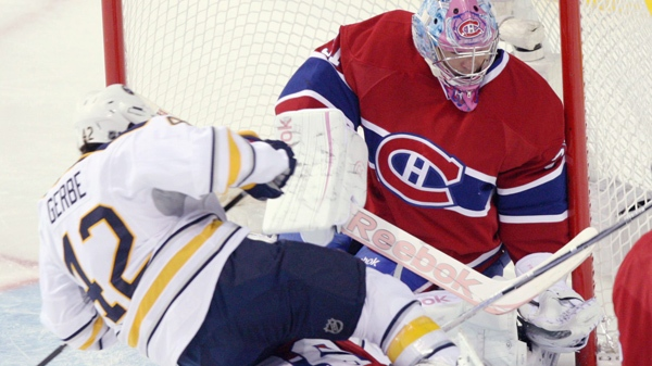 Buffalo Sabres left wing Nathan Gerbe (42) falls over Montreal Canadiens defenseman P.K. Subban (76) in front of Montreal Canadiens goalie Carey Price (31) during first period National Hockey League actionTuesday, October 18, 2011 in Montreal.THE CANADIAN PRESS/Ryan Remiorz
