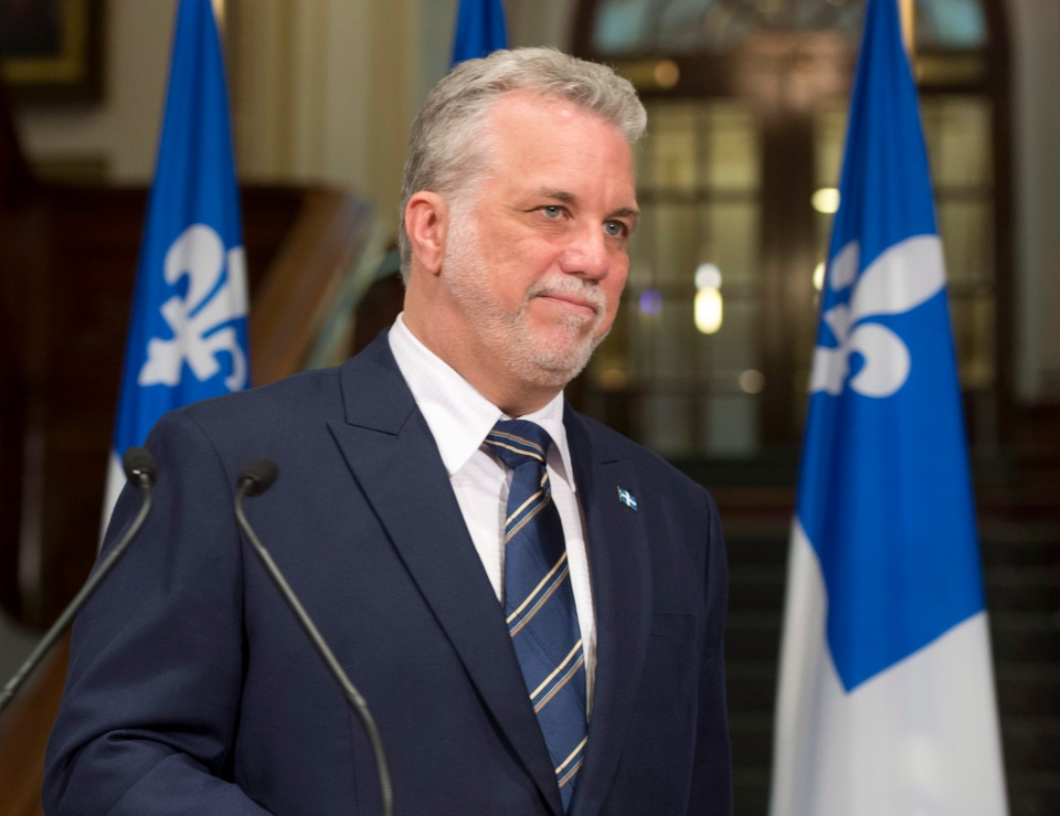 Quebec Premier designate Philippe Couillard walks away following a news conference, Tuesday, April 8, 2014 at the legislature in Quebec City. Quebecers elected a Liberal majority government on April 7. THE CANADIAN PRESS/Jacques Boissinot