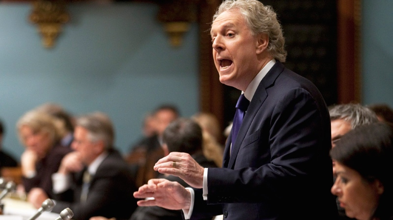 Quebec Premier Jean Charest defends his government over an announcement of a commission of inquiry in the construction industry at the legislature in Quebec City, Thursday, Oct. 20, 2011. (Jacques Boissinot / THE CANADIAN PRESS)