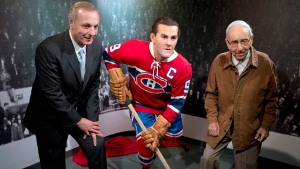 Former Montreal Canadiens Guy Lafleur, left, and Bob Fillion, 94, who won the Stanley Cup with the Richard in 1944 and 1945, pose with wax statue of Maurice 'Rocket' Richard, April 10, 2014 in Montreal. (Ryan Remiorz / The Canadian Press)