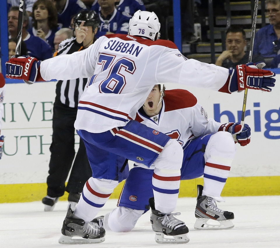 Montreal Canadiens right wing Dale Weise, right, celebrates with defenseman P.K. Subban (76) after scoring against the Tampa Bay Lightning during overtime of Game 1 of a first-round NHL hockey playoff series Wednesday, April 16, 2014, in Tampa, Fla. The Canadiens won the game 5-4. (AP Photo/Chris O'Meara)