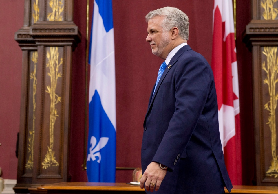 Quebec Premier designate Philippe Couillard walks to his seat following his speech at the swearing in ceremony, Thursday, April 17, 2014 at the legislature in Quebec City. THE CANADIAN PRESS/Jacques Boissinot
