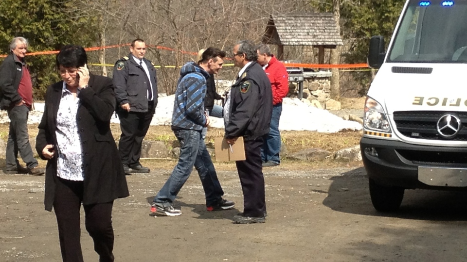 Officials at site of landslide in Ste. Sophie on Monday April 21, 2014 (CTV Montreal/Derek Conlon)