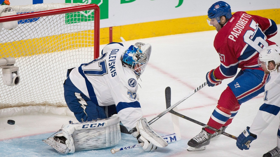 Montreal Canadiens' Max Pacioretty slides in on Tampa Bay Lightning's goaltender Kristers Gudlevskis during second period NHL Stanley Cup playoff action in Montreal, Tuesday, April 22, 2014. (Graham Hughes / THE CANADIAN PRESS)