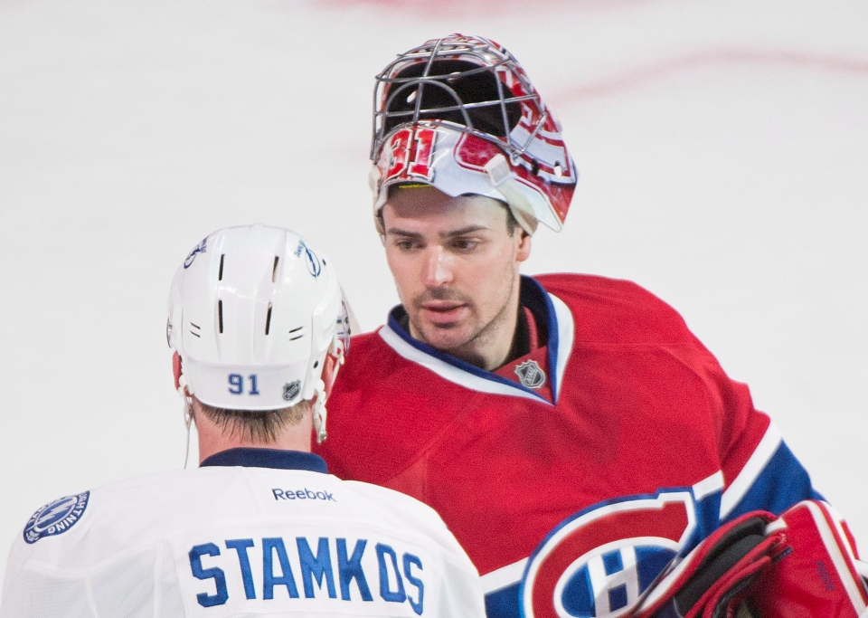Montreal Canadiens' goaltender Carey Price shakes hands with Tampa Bay Lightning's Steven Stamkos after the Canadiens defeated the Lightning in NHL Stanley Cup playoff action in Montreal, Tuesday, April 22, 2014. THE CANADIAN PRESS/Graham Hughes