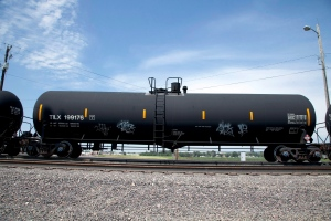 In this Aug. 8, 2012 photo, a DOT-111 rail tanker passes through Council Bluffs, Iowa. (AP Photo/Nati Harnik)