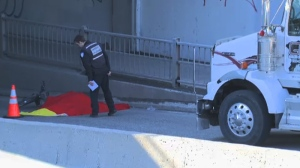 Authorities are seen investigating the scene of the fatal accident on St. Denis early Monday morning. (CTV Montreal April 28, 2014)
