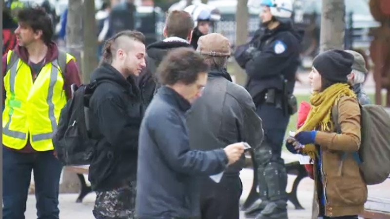Demonstrators are seen organizing prior to an anti-capitalist May Day protest at Papineau and Ontario Thursday. (CTV Montreal May 1, 2014)