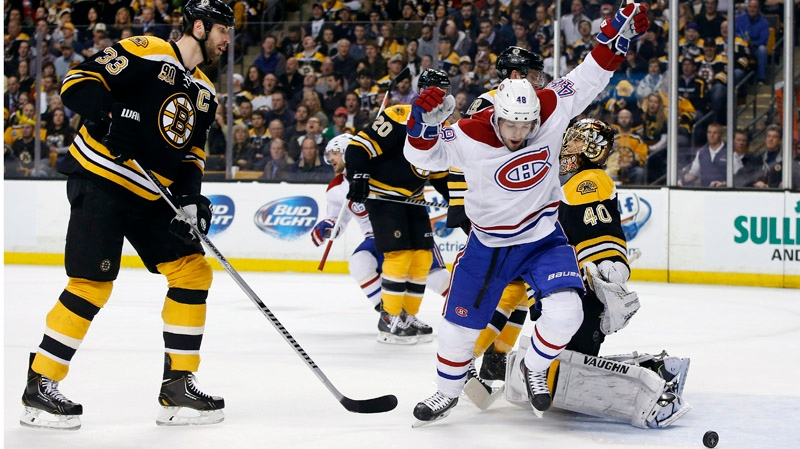 Montreal Canadiens center Daniel Briere (48) celebrates a goal by teammate P.K. Subban as Boston Bruins defenseman Zdeno Chara (33) is near during the first period in Game 1 of an NHL hockey second-round playoff series in Boston, Thursday, May 1, 2014. (AP Photo/Elise Amendola)