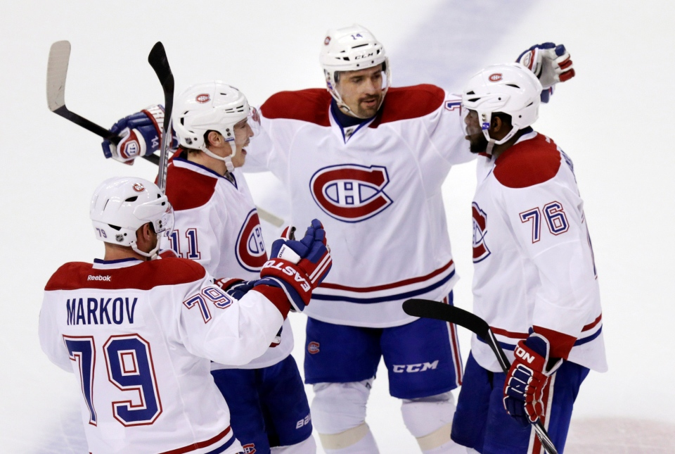 Montreal Canadiens defenseman P.K. Subban (76) is congratulated by teammates after his goal against Boston Bruins goalie Tuukka Rask during the first period of Game 1 in the second round of the Stanley Cup playoff series in Boston, Thursday, May 1, 2014. (AP Photo/Charles Krupa)