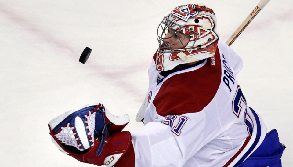 Montreal Canadiens goalie Carey Price gloves a save against the Boston Bruins during the first period of Game 1 in the second-round of a Stanley Cup playoff series in Boston, Thursday, May 1, 2014. (AP Photo/Charles Krupa)