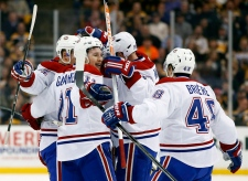 Montreal Canadiens celebrate a goal by teammate P.