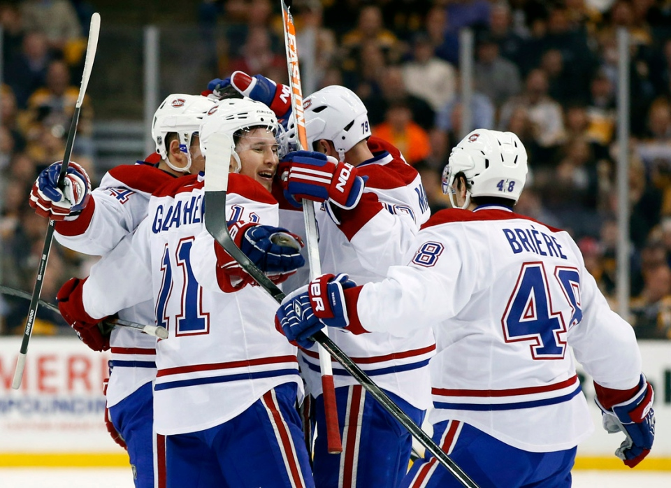 Montreal Canadiens celebrate a goal by teammate P.K. Subban against the Boston Bruins during the first period in Game 1 of an NHL hockey second-round playoff series in Boston, Thursday, May 1, 2014. (AP Photo/Elise Amendola)