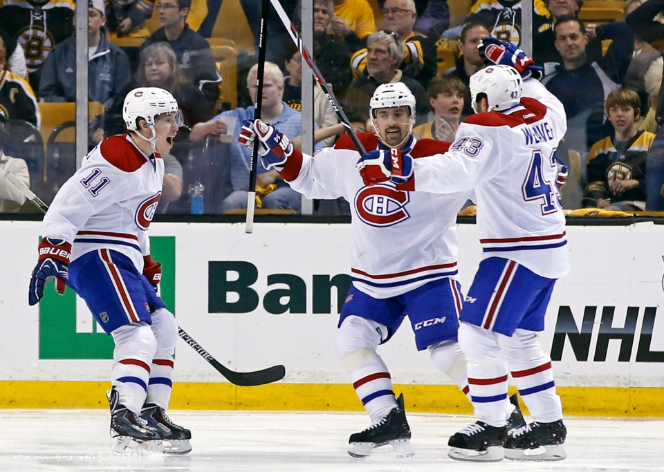Montreal Canadiens right wing Brendan Gallagher (11) and centre Tomas Plekanec (14) celebrate after a goal by defenseman Mike Weaver (43) against the Boston Bruins during the second period in Game 2 of an NHL hockey second-round Stanley Cup playoff series in Boston, Saturday, May 3, 2014. (AP / Elise Amendola)