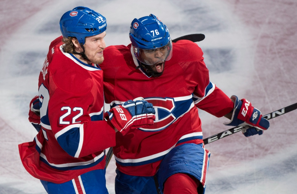 Montreal Canadiens' P.K. Subban celebrates with teammate Dale Weise after scoring past Boston Bruins goalie Tuukka Rask during first period NHL hockey action Tuesday, May 6, 2014 in Montreal. THE CANADIAN PRESS/Paul Chiasson