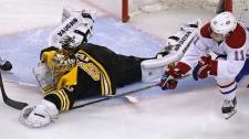 Boston Bruins goalie Tuukka Rask (40) dives out of