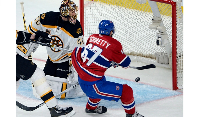Montreal Canadiens' Max Pacioretty (67) scores the second goal against Boston Bruins goalie Tuukka Rask (40) during second period NHL Stanley Cup playoff hockey action on Monday, May 12, 2014 in Montreal. THE CANADIAN PRESS/Ryan Remiorz