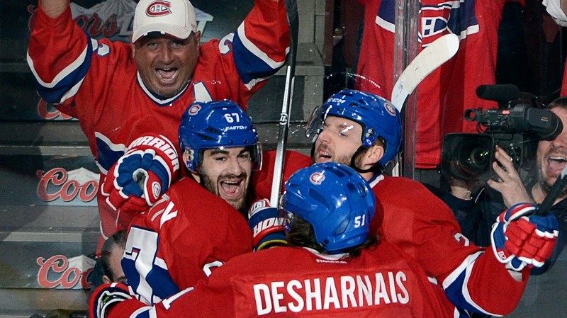 Montreal Canadiens' Thomas Vanek (20) celebrates with teammates Max Pacioretty (67) and David Desharnais(51) after scoring the third goal against the Boston Bruins during second period NHL Stanley Cup playoff hockey action on Monday, May 12, 2014 in Montreal. THE CANADIAN PRESS/Ryan Remiorz