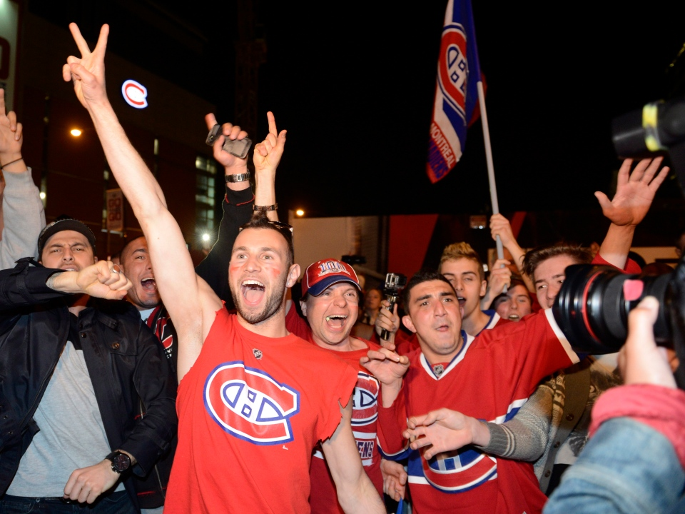 Montreal Canadiens fans celebrate their team's NHL playoff win over the Boston Bruins in Montreal Wednesday May 14, 2014. (Ryan Remiorz / THE CANADIAN PRESS)
