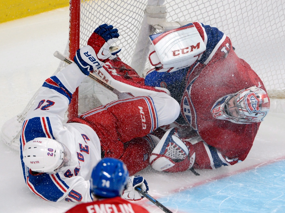 New York Rangers left wing Chris Kreider (20) crashes into Montreal Canadiens goalie Carey Price (31) during second period NHL playoff action in Montreal on Saturday, May 17, 2014. THE CANADIAN PRESS/Ryan Remiorz