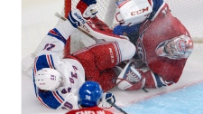 New York Rangers Chris Kreider crashes into Montre