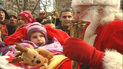 Santa Claus visited boys and girls in Montreal Saturday.