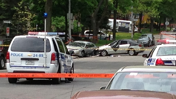 Police cars block St. Joseph Blvd. where a driver smashed into a parked car on Thursday, May 22, 2014 (Steve Rompre/CTV Montreal)