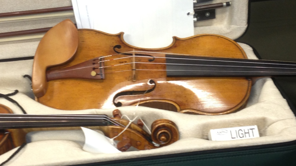 One of the stolen violins recovered by provincial police (Derek Conlon/CTV Montreal)