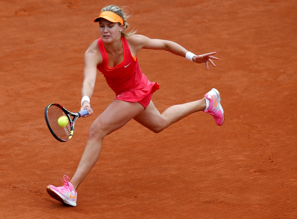 Canada's Eugenie Bouchard returns the ball to Germany's Angelique Kerber in their fourth-round match at the French Open tennis tournament at Roland Garros stadium in Paris, France Sunday, June 1, 2014. Bouchard won 6-1, 6-2. (AP Photo/David Vincent)